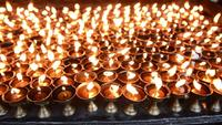 Burning candles at Buddhist site of Boudhanath, Kathmandu, Nepal