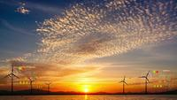 Sunset Time Lapse with wind Turbines and Digital Data.