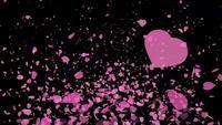 Hjärtor som flyger på svart skärmbakgrund