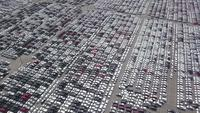 Aerial view of new cars distribution center in seaport.