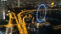 Hyper lapse de Singapore Flyer en la noche