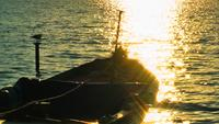 Fishing Boat and Sunlight in the Lake