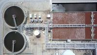 Aerial Drone view move up from clarifier sedimentation tank. Aerial view Water treatment plant.