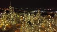 Night time aerial shot from oil tanks in a refinery
