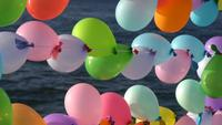 Colorful party balloons at outside at the beach
