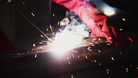 Worker Using Metal Welding Machine