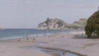 Super 8 - Menschen an einem Strand in Neuseeland