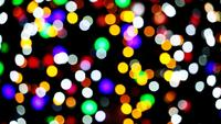 Blur and Bokeh Rainbow Colorful Light on The Night Wall