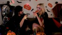 Couple drinks  together at Halloween party