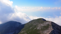 Flying over the Monte Baldo Mountain Peak