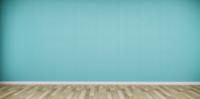 Ein breiter leerer Raum mit einem Holzboden und einer grünen Wand