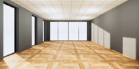 Pared de color gris y piso de madera en una habitación grande