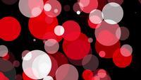 Rote Kreise, die sich auf schwarzem Hintergrund bewegen