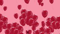 Rosa Luftballons, die langsam auf einem rosa Hintergrund schweben