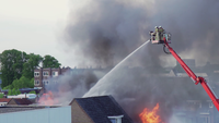 Fireman fighting fire from a platform