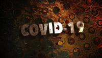 Text Covid-19 on dark background with blood