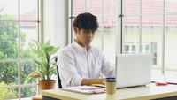 Young Businessman Sitting At Work With Stress
