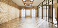Oficina muerta estilo loft con paredes de ladrillo
