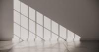Habitación luminosa con luz solar en el suelo y las paredes