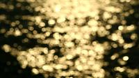 Golden Light Blurred Reflection in Water