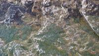 Gotas de lluvia abstractas en granito