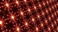 Estrellas naranjas brillantes pulsando en una pared de matriz