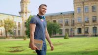Handsome Student Walks on A Sunny Day