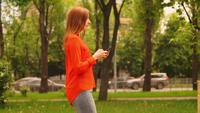Profile millennial with gadget typing message outdoors