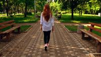Female with red hair strolls in the city