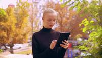 Portrait caucasian woman using device outdoors